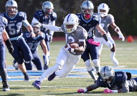 New Rochelle's Jessie Parson (12) looks for some running room in the John Jay defense during the Section 1 championship game at Mahopac High School Nov. 3,  2018.