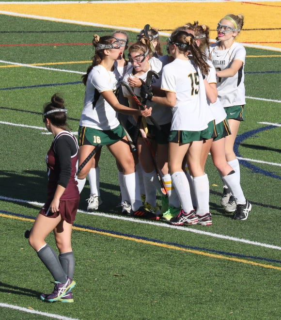 Lakeland's Julianna Cappello is surrounded by teammates after her goal against Burnt Hills during their regional field hockey game at Lakeland High School, Nov. 3, 2018.