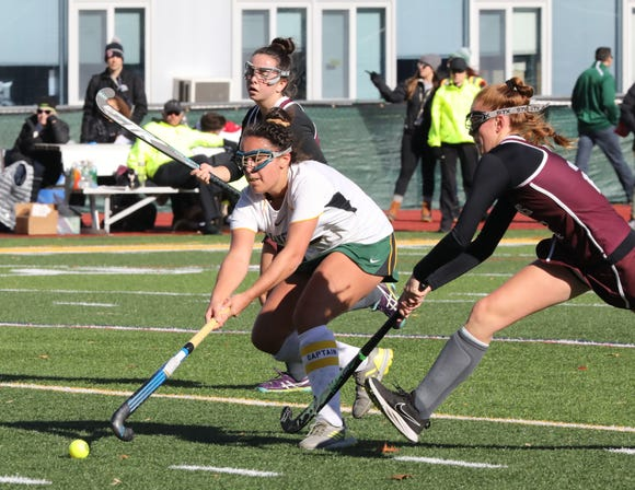 Lakeland's Emily Kness moves the ball against Burnt Hills during their regional field hockey game at Lakeland High School, Nov. 3, 2018.