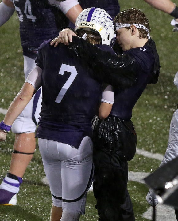 John Jay-Cross River senior Bryce Ford (7) is embraced by his brother Dean, a senior on the football team who suffered a season-ending injury in September. Ford led John Jay over Rye 21-14 to win the Section 1 championship at Mahopac High School Nov. 2, 2018.