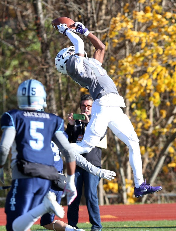 New Rochelle's Jessie Parson (12) goes up high to catch this second half pass against John Jay during the Section 1 championship game at Mahopac High School Nov. 3,  2018.