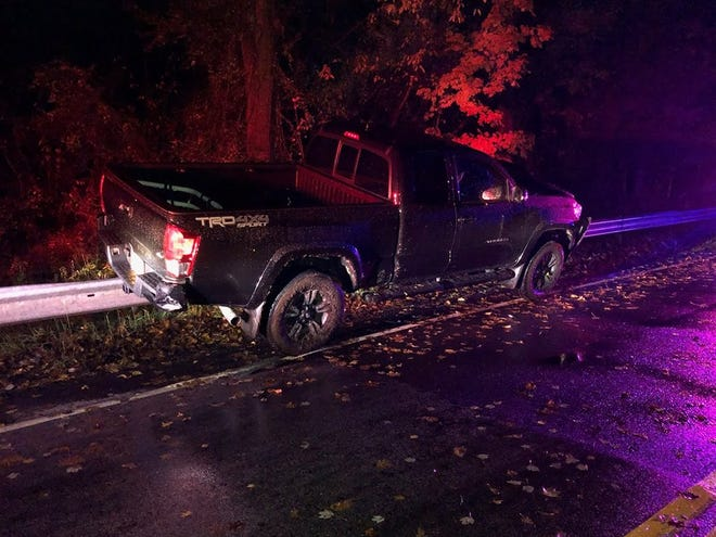 The driver of this Toyota got stuck on the guardrail on Grandview Avenue in Wesley Hills on Saturday. He was charged with felony driving while intoxicated.