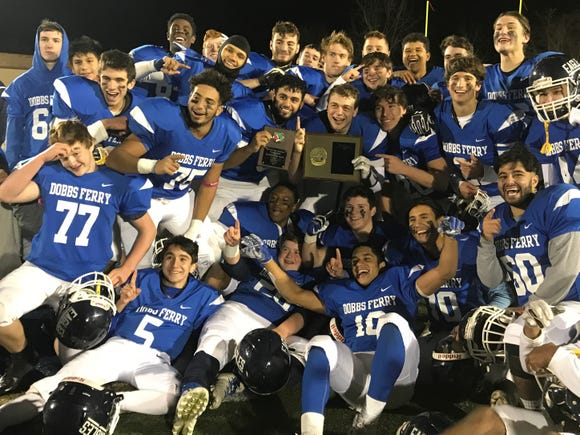 Dobbs Ferry's football team celebrates after defeating Woodlands 35-8 in the Section 1 Class C championship game on Saturday, November 3rd, 2018.