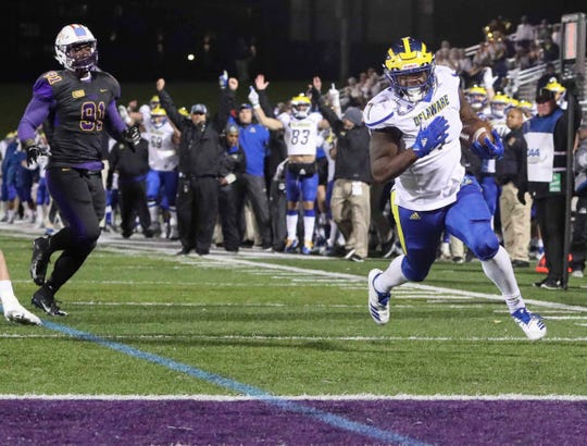 Delaware running back Kani Kane heads for the end zone on his go-ahead score in the final minute of the Blue Hens' 21-16 win at  Albany Saturday.