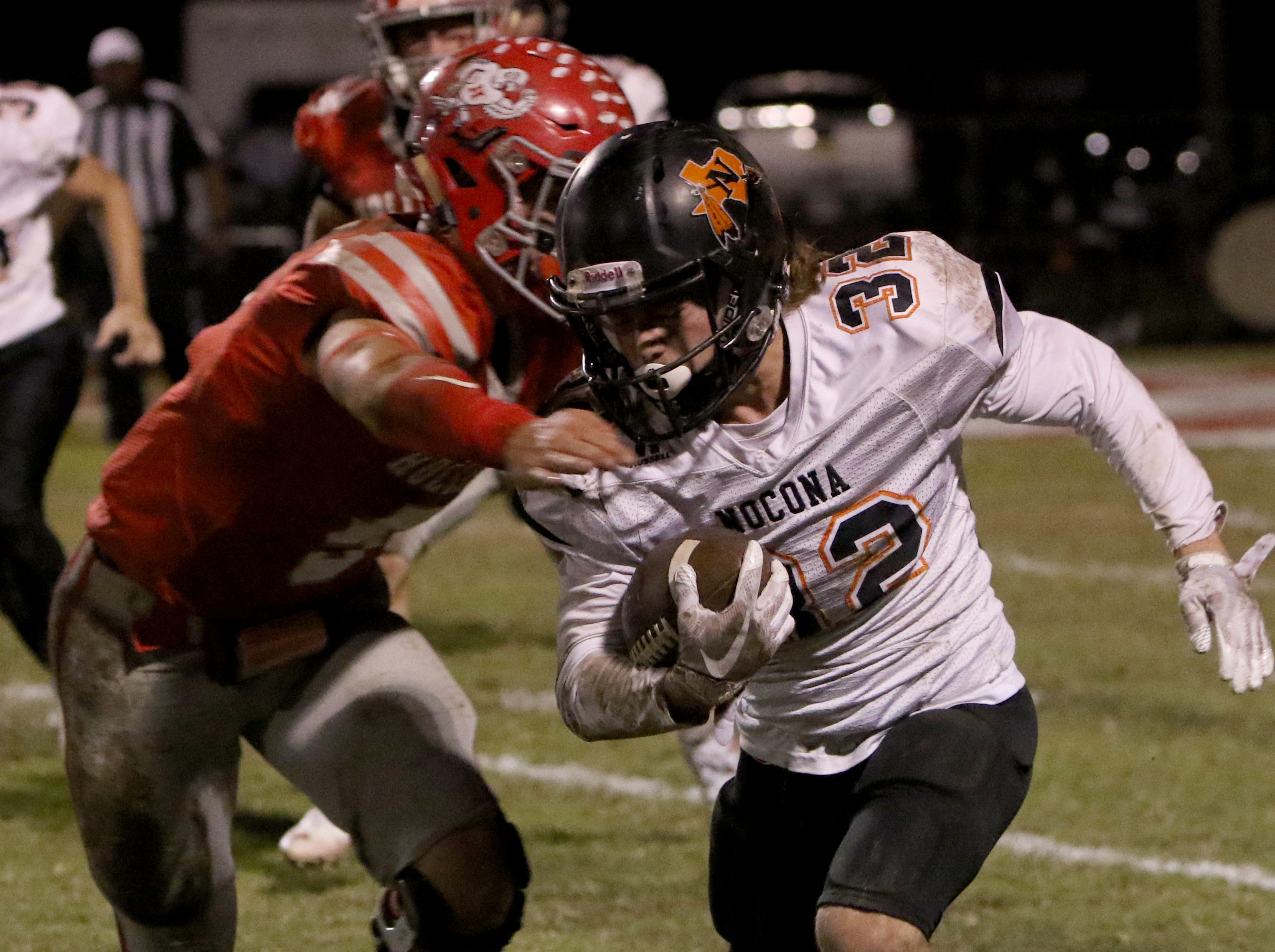 Nocona's Hunter Fenoglio is tackled by Holliday's Jett Johnson Friday, Nov. 2, 2018, at Eagle Stadium in Holliday. The Eagles defeated the Indians 38-0.