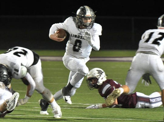 Lindsay Knight's Quarterback, Seth Foster works to gain some yardage against the Seymour Panthers Friday during their game in Seymour Friday night.