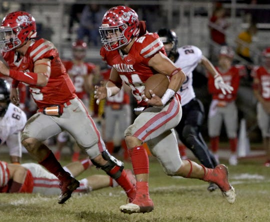 Holliday's Tristin Boyd runs untouched in a 2018 game against Nocona