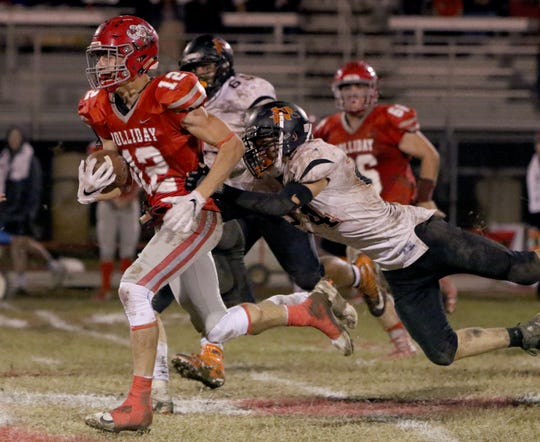 Holliday's Connor Cox is tackled by Nocona's Jase Davis Friday, Nov. 2, 2018, at Eagle Stadium in Holliday. The Eagles defeated the Indians 38-0.