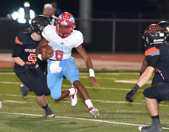 Hirschi Huskies quarterback Nate Downing (6) runs up the middle against the Springtown Porcupines in the first quarter Friday night in Springtown.