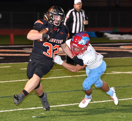 Springtown Porcupines Cameron Rickett (32) tries to get away from Hirschi defender JaRon Jordan during second quarter action Friday night in Springtown.