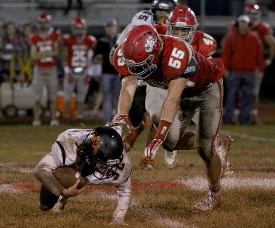 Holliday's Tanner Bayard sacks Nocona's Hunter Fenoglio Friday, Nov. 2, 2018, at Eagle Stadium in Holliday. The Eagles defeated the Indians 38-0.