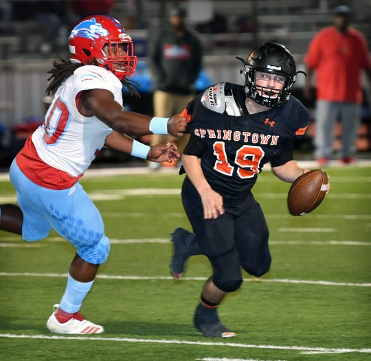 Springtown quarterback Sawyer Drewry (19) is sacked by Hirschi linebacker Cameron Whitehead (30) in the second quarter Friday night in Springtown.