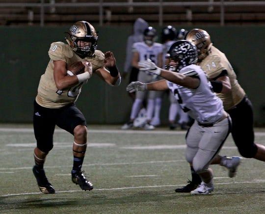 Rider quarterback Jacob Rodriguez (10) tries to stiff arm Randall's Caleb Frausto (52) during a rushing attempt on Friday, Nov. 2, 2018 at Memorial Stadium.