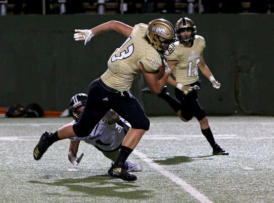 Rider's Kyler Spear (13) avoids Randall's Hagen Escoto (1) after making a catch on Friday, Nov. 2, 2018 at Memorial Stadium.