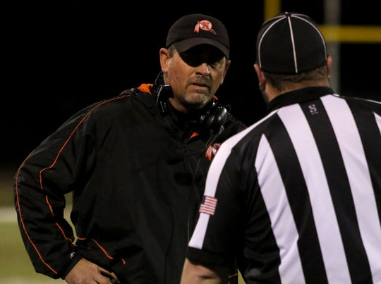 Nocona head football coach Brad Keck speaks with an official in the game against Holliday Friday, Nov. 2, 2018, at Eagle Stadium in Holliday. The Eagles defeated the Indians 38-0.