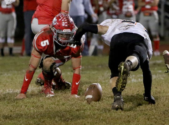 Holliday's Jett Johnson goes after his fumble but it's recovered by Nocona's Jase Davis Friday, Nov. 2, 2018, at Eagle Stadium in Holliday. The Eagles defeated the Indians 38-0.