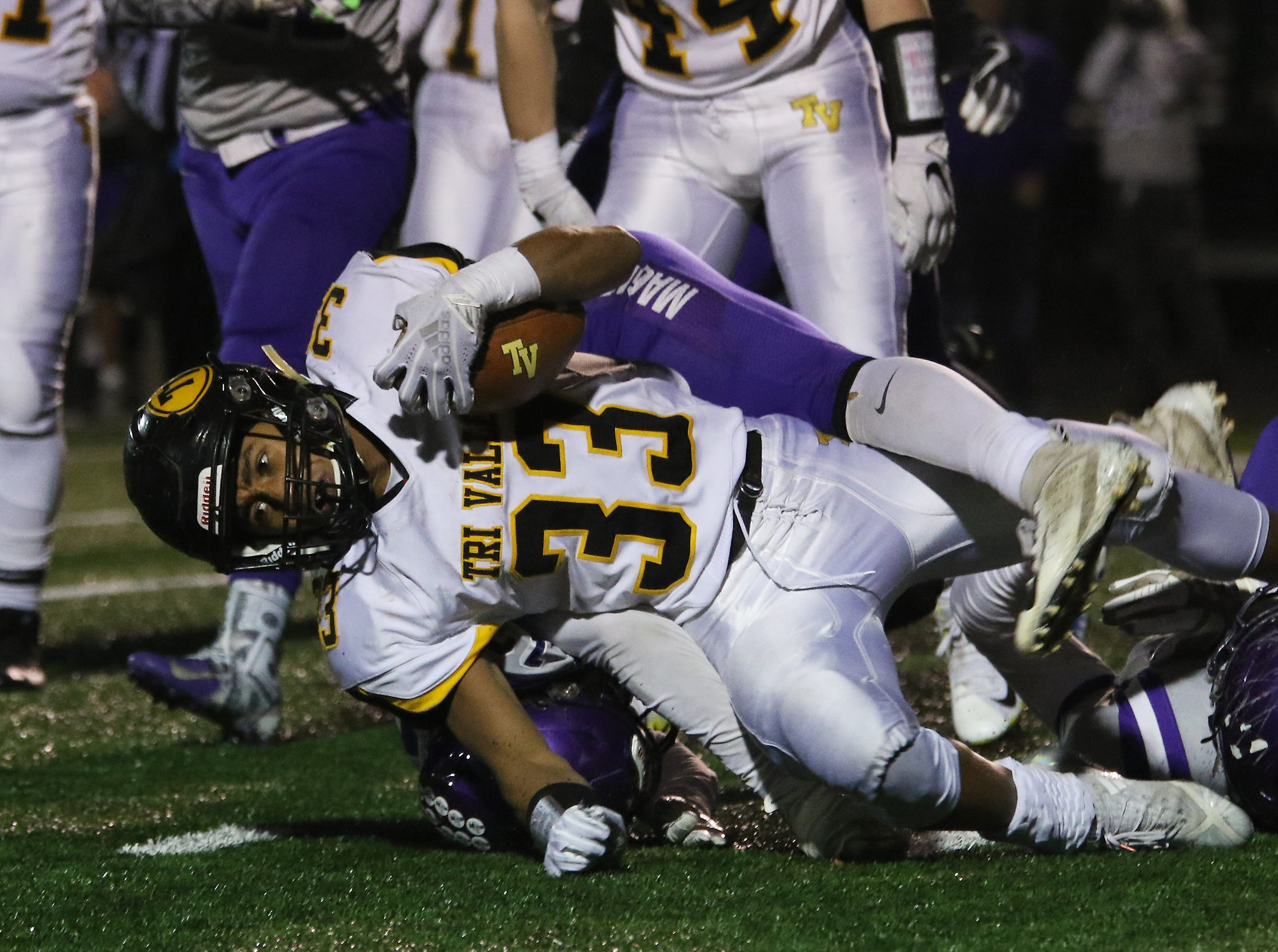 Tri-Valley's Jordan Pantaleo lunges for an extra yard against Barberton.