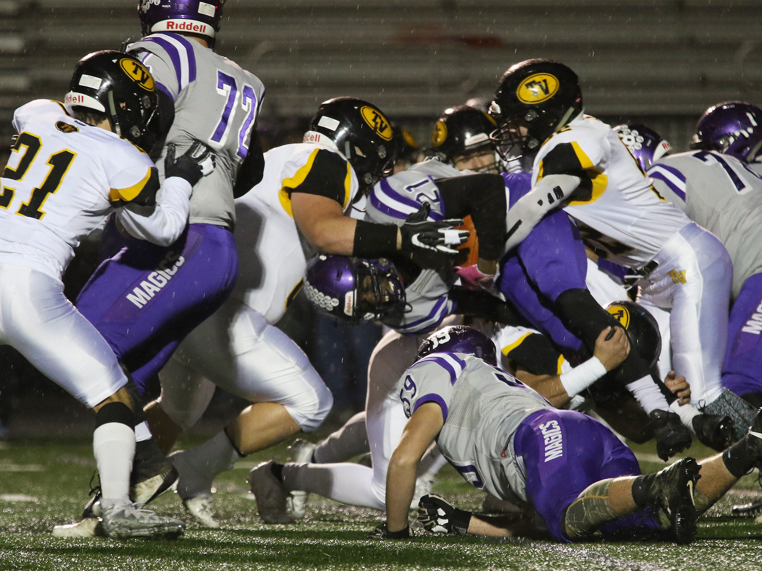 The Tri-Valley defense stops Barberton's Kyree Young.