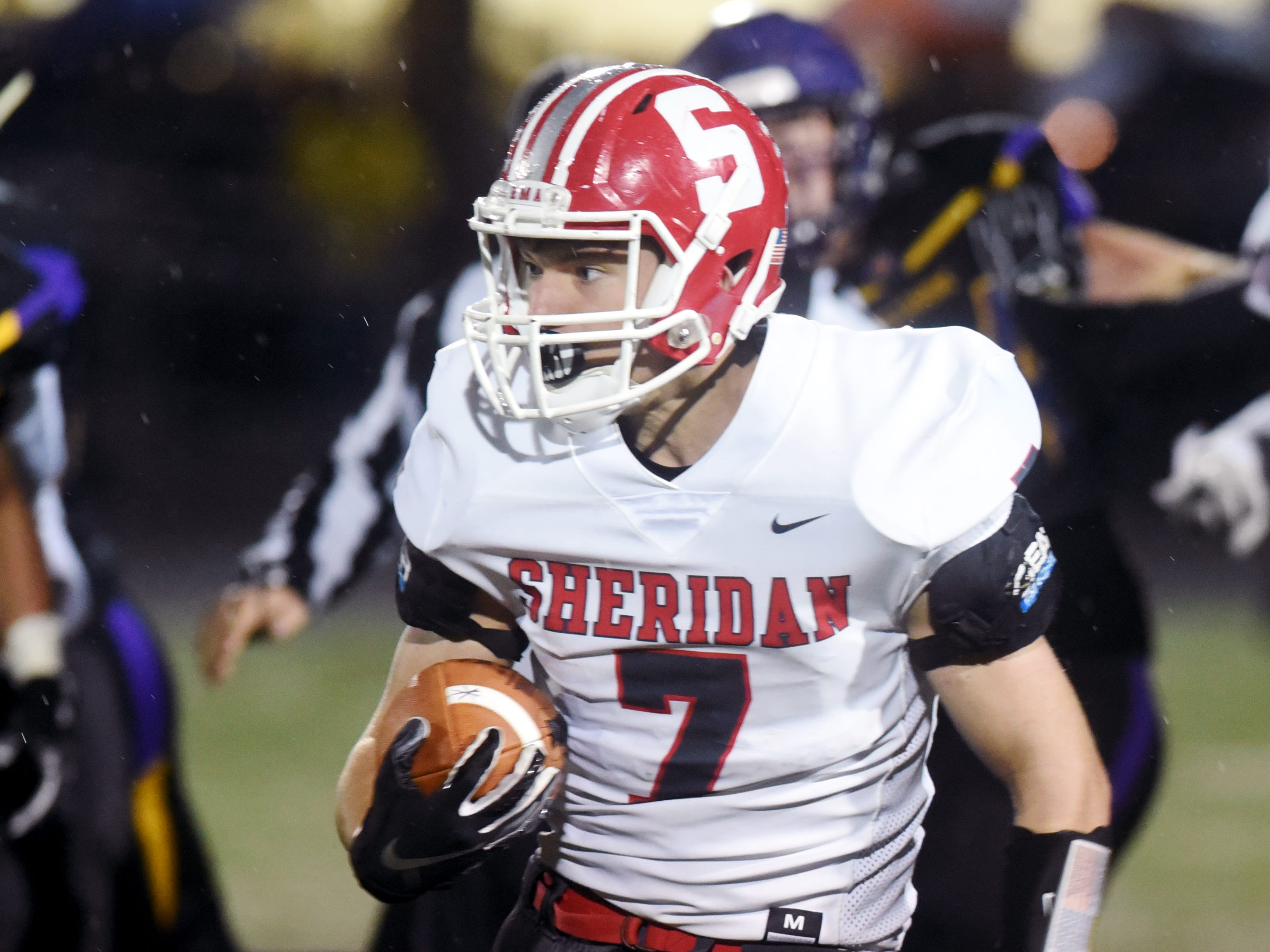 Will Hamilton looks for room to run during Sheridan's 27-19 win against No. 2 ranked Bellbrook in a Division III, Region 11 quarterfinal on Friday at Miami Valley South Stadium.