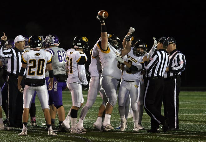 Tri-Valley celebrates a fumble recovery against Barberton in last Friday's 10-0 win. The Scottie defense has posted four shutouts in their last six games with unbeaten Wadsworth up next in Friday's Division II, Region 7 semifinal.