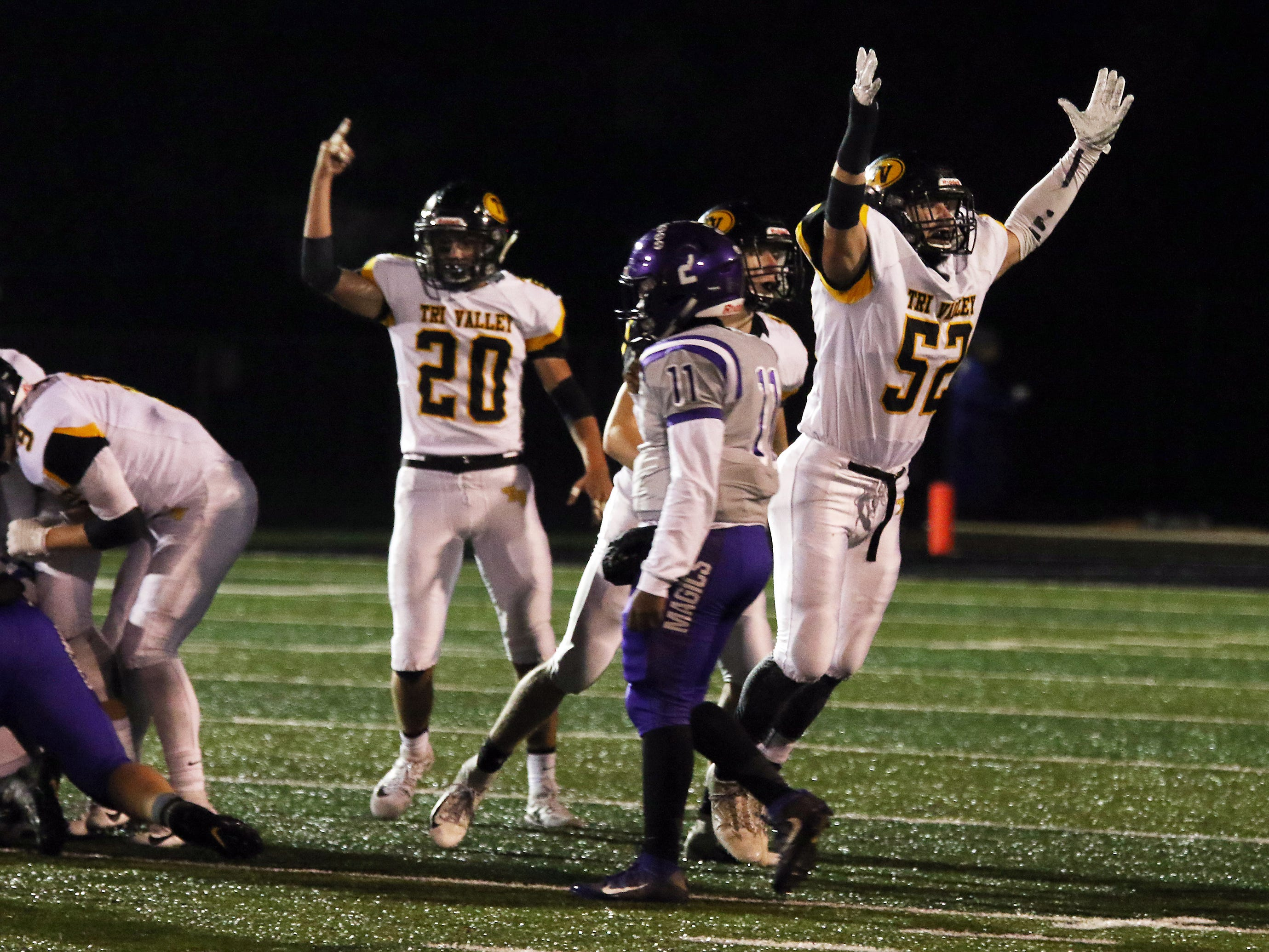 Tri-Valley's Tom Reiss celebrates a Barberton fumble recovery.