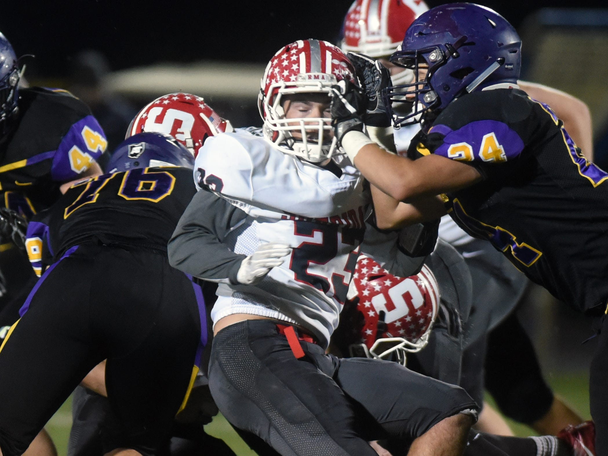 Nick Ranalli tries to fight off a block during Sheridan's 27-19 win against No. 2 ranked Bellbrook in a Division III, Region 11 quarterfinal on Friday at Miami Valley South Stadium.