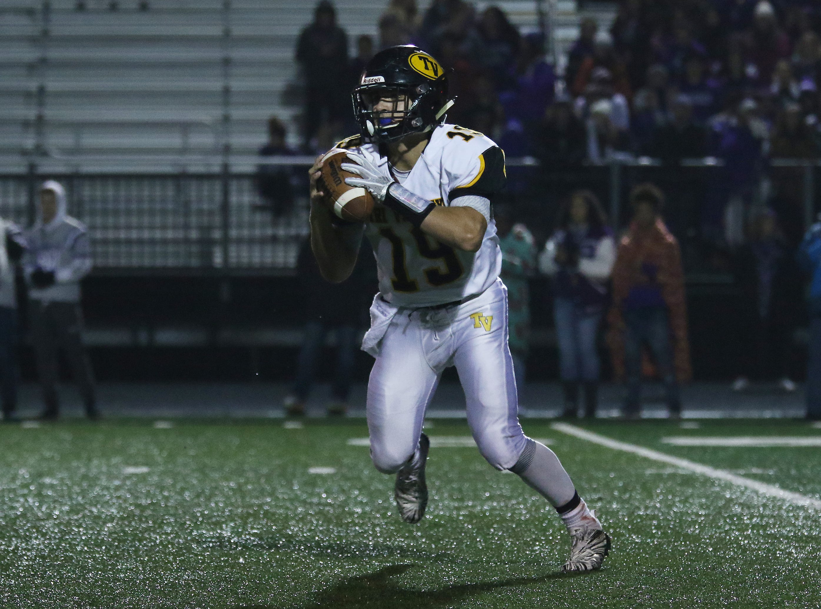 Tri-Valley's Aiden Fritter scrambles against Barberton.