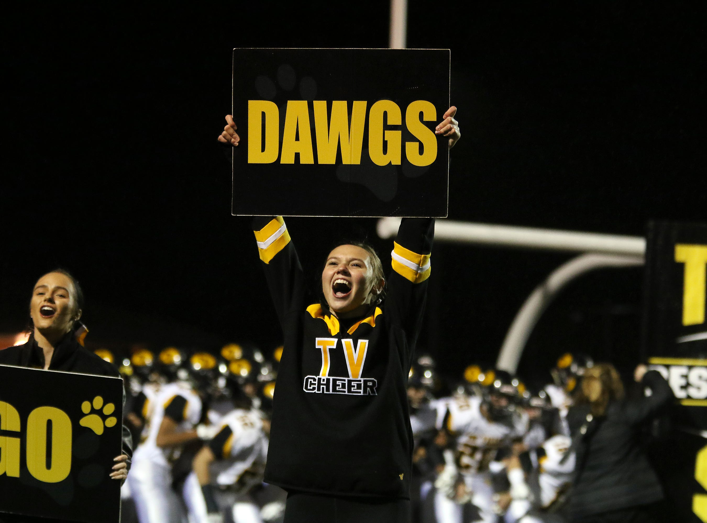 A Tri-Valley cheerleaders gets the crowd ready for the Scottie's arrival to play Barberton.
