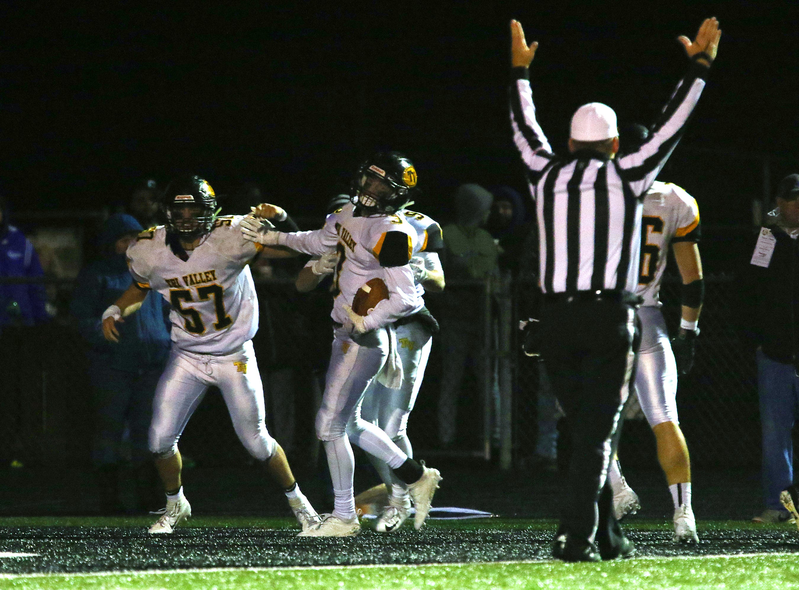 Tri-Valley's Cade Sterling scores a touchdown on an interception return against Barberton.