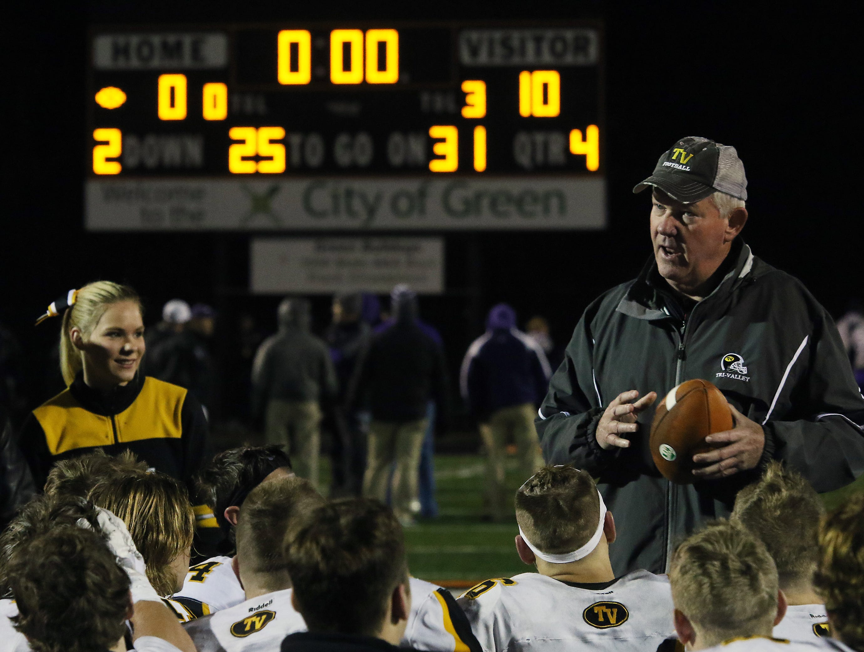Tri-Valley head coach Kevin Fell talks to his team after defeating Barberton.