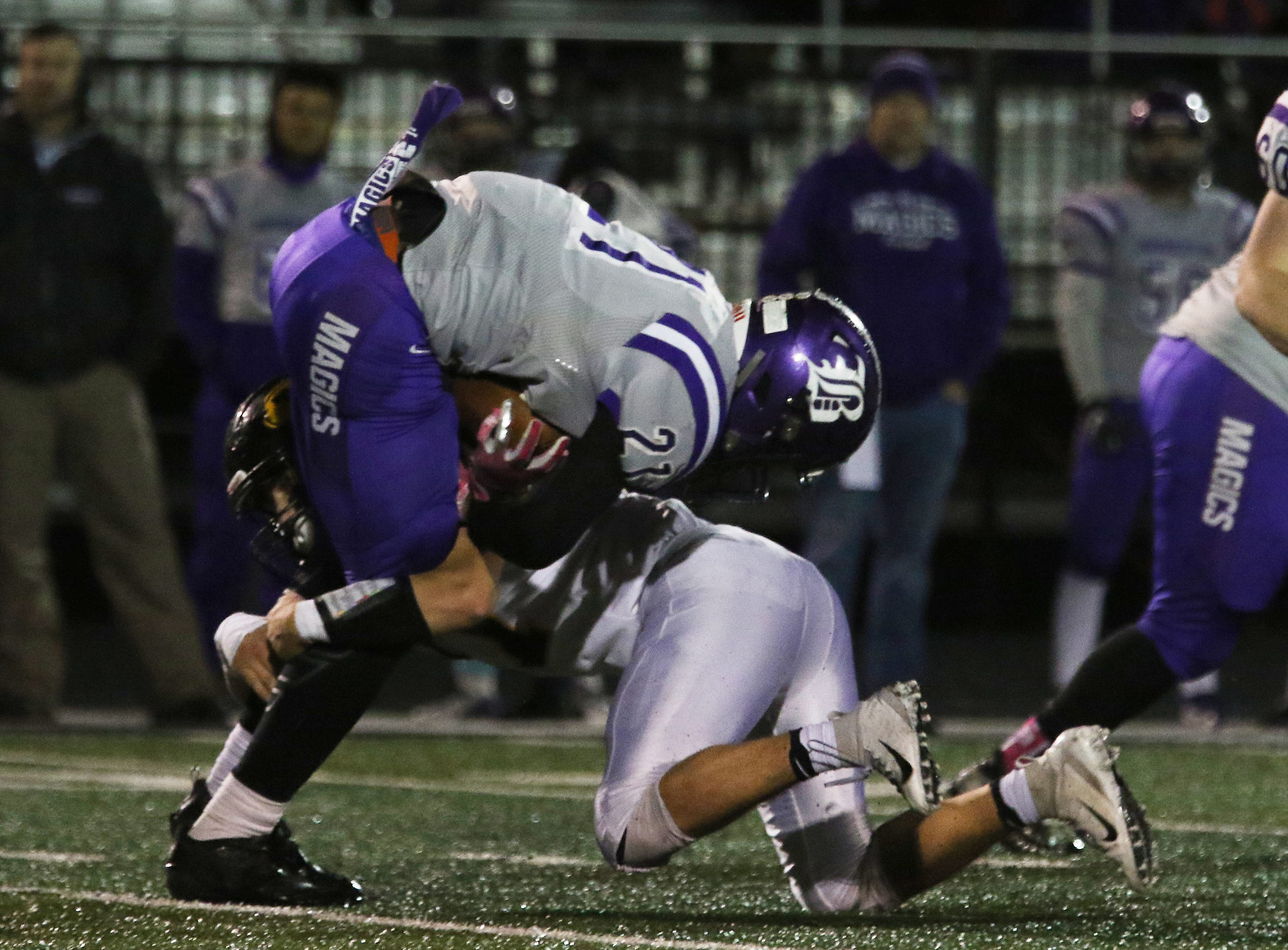 A Tri-Valley defender takes down Barberton's Kyree Young.