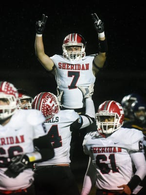 Senior Collin Hill holds up classmate Will Hamilton after scoring a 10-yard touchdown in the fourth quarter of Sheridan's 27-19 win against Bellbrook in a Division III, Region 11 quarterfinal game at Miami Valley South Stadium. It was the Generals' first playoff win since 2009.