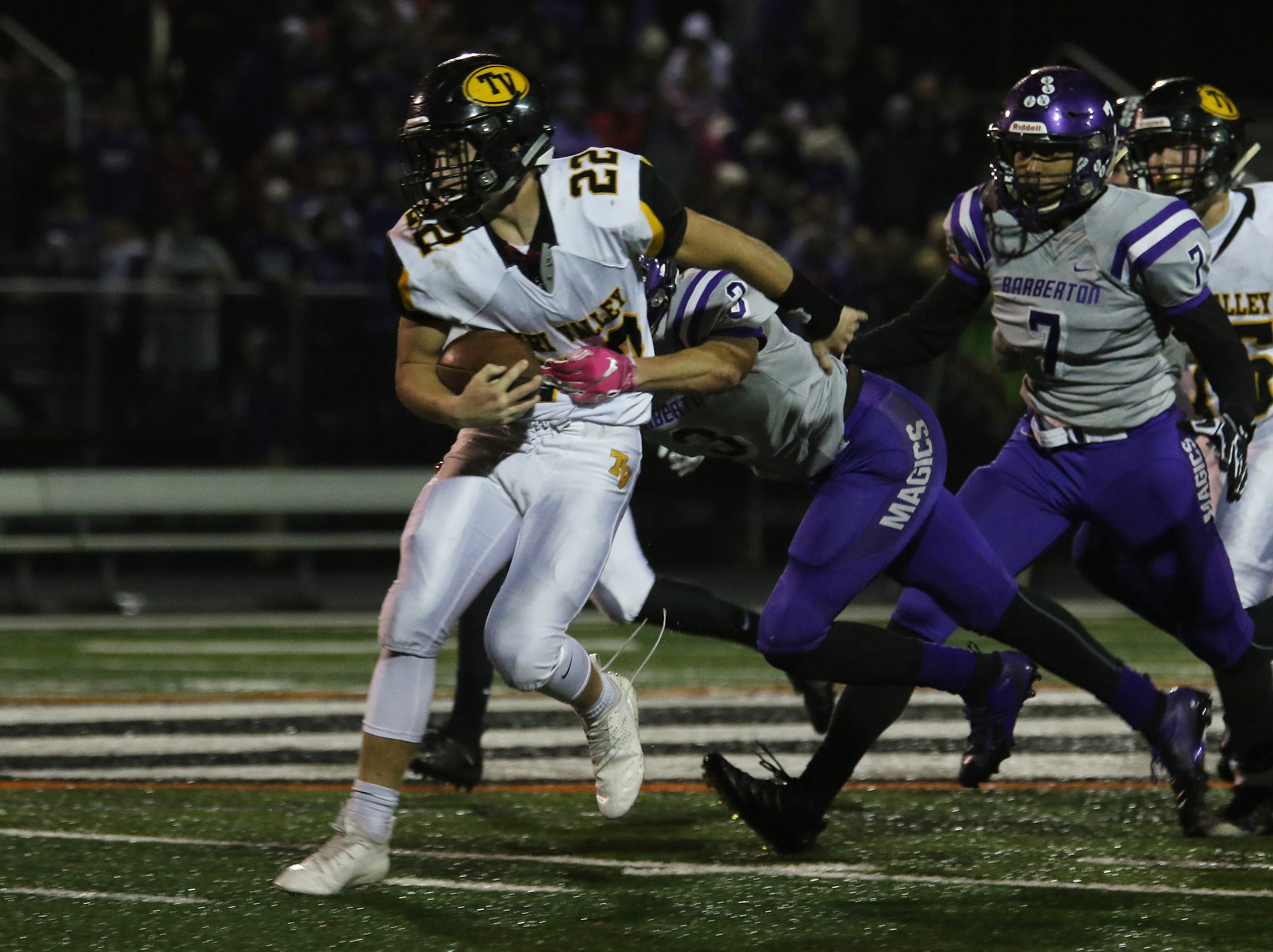 Tri-Valley's Blake Sands carries the ball against Barberton.
