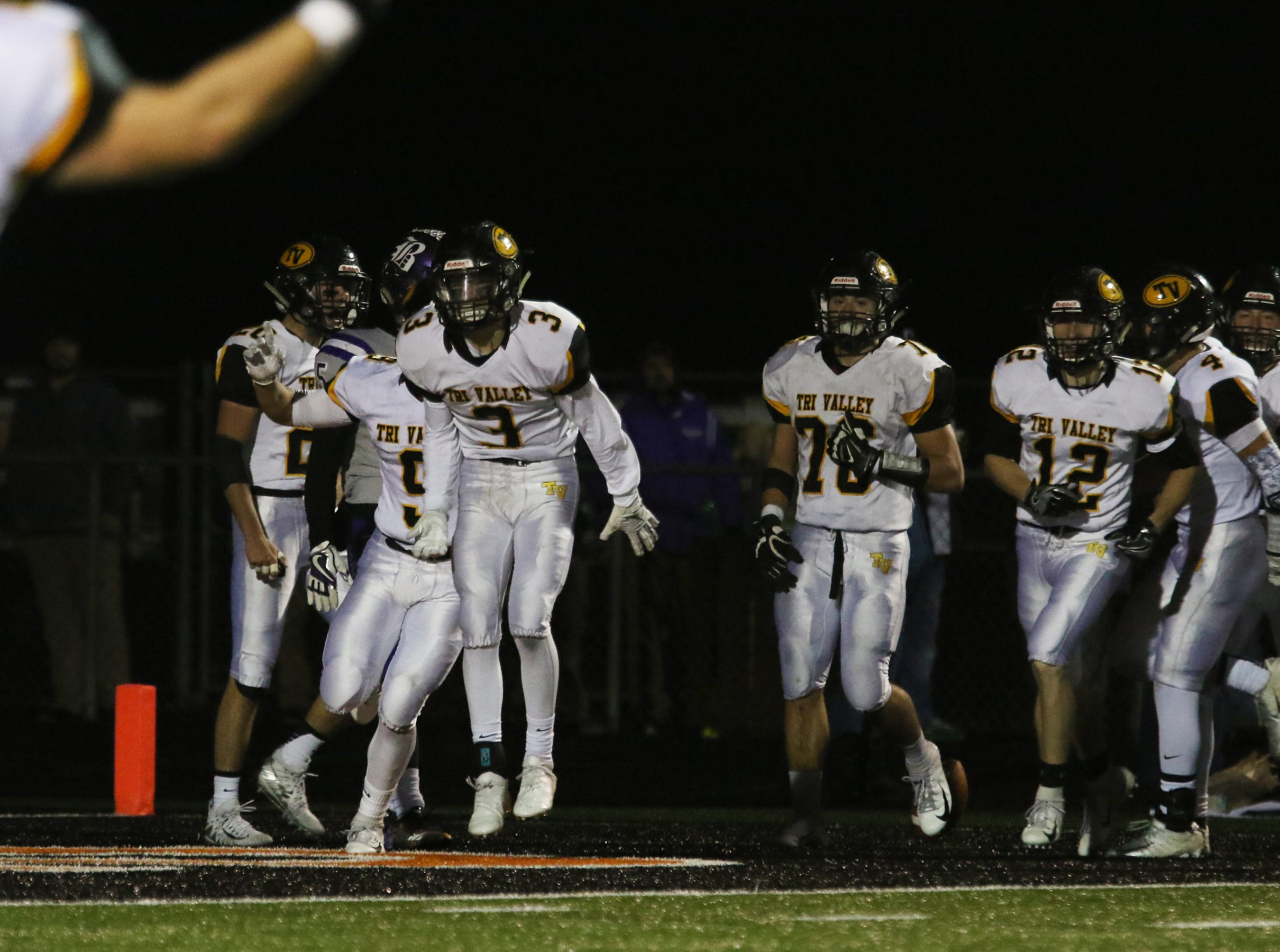Tri-Valley celebrates Cade Sterling's interception return against Barberton.