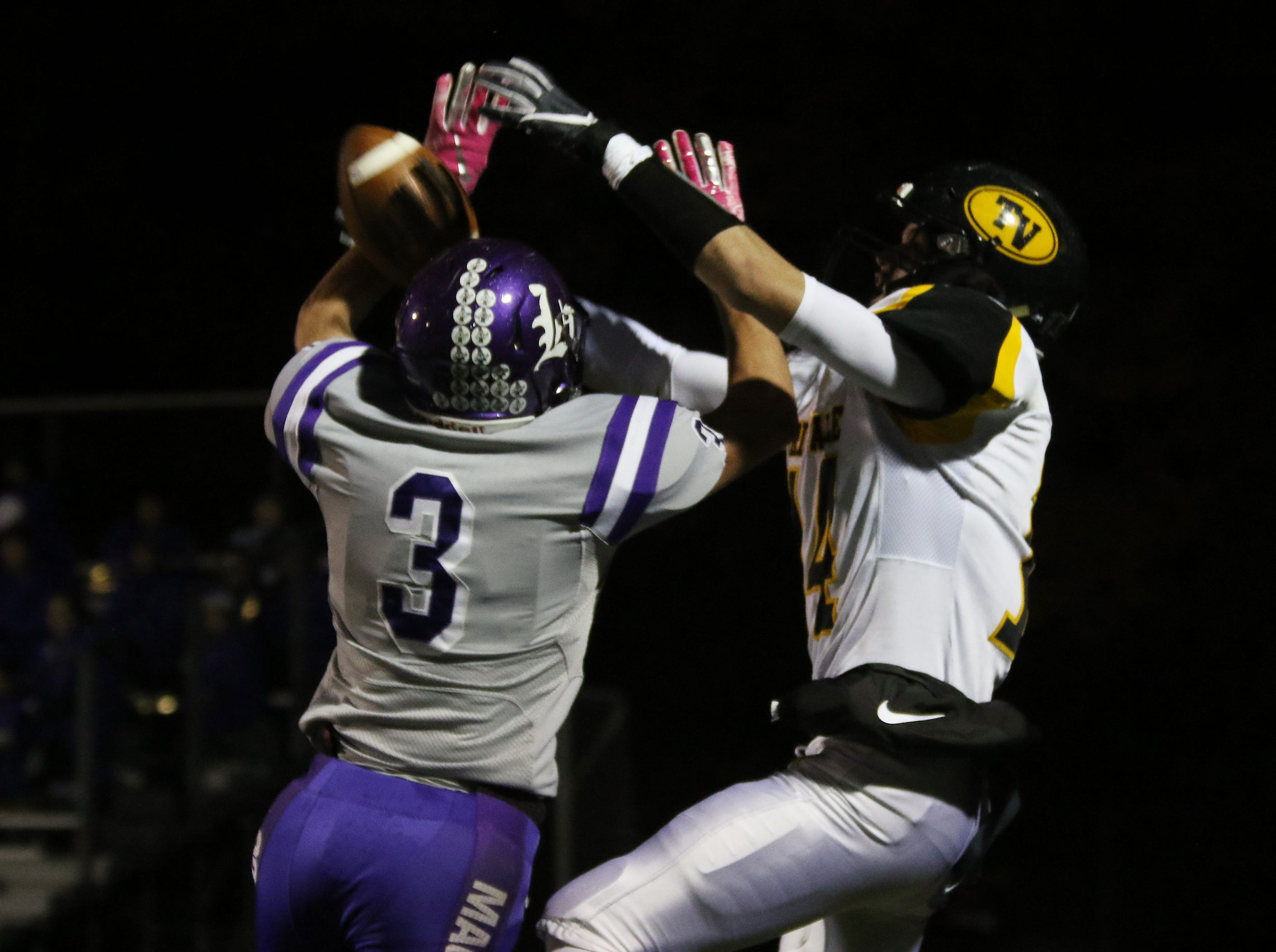 Barberton's Spencer Hutchison breaks up a pass intended for Tri-Valley's Keaton Williams.