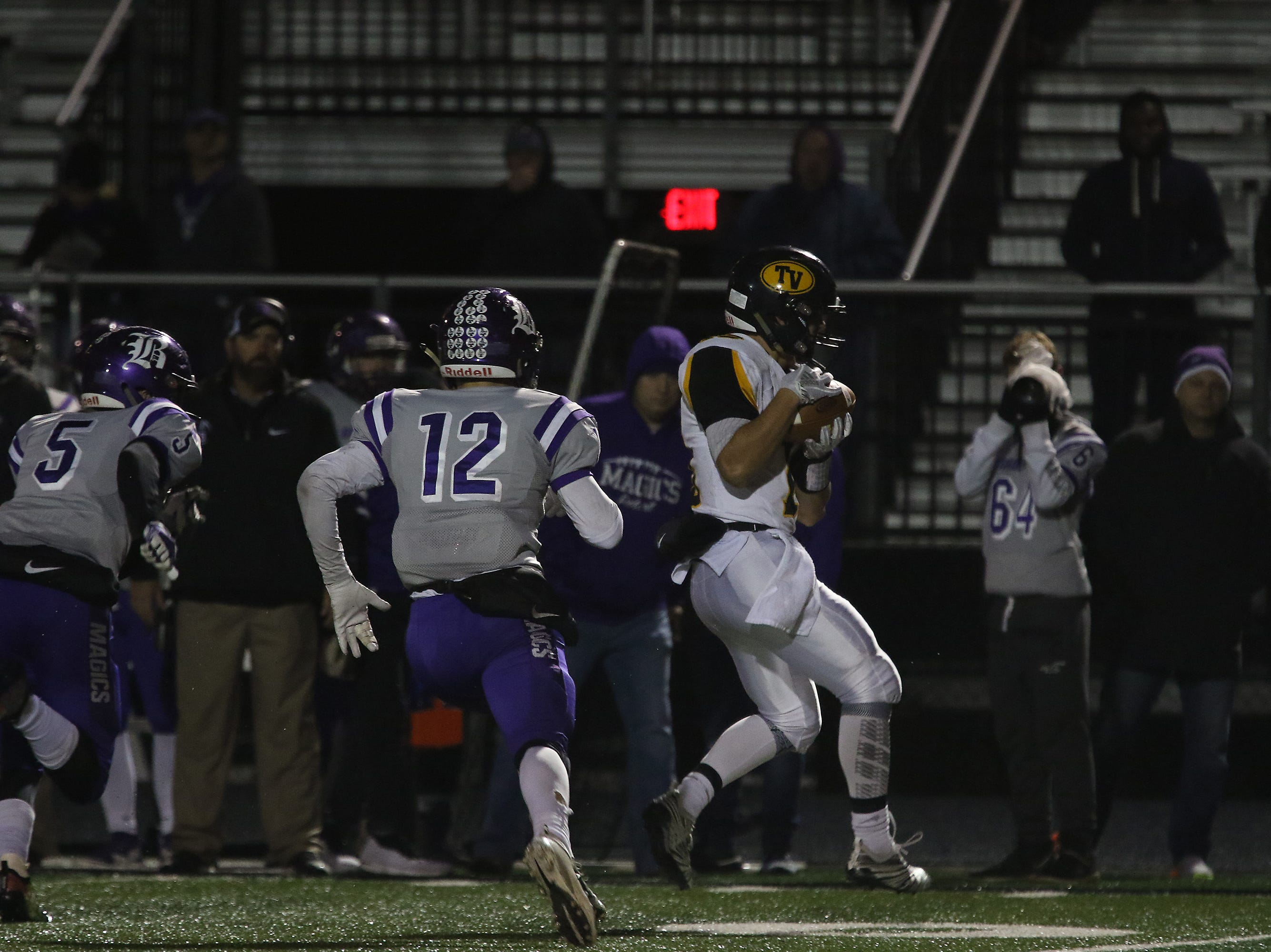 Tri-Valley's Aiden Fritter pulls in a pass against Barberton.