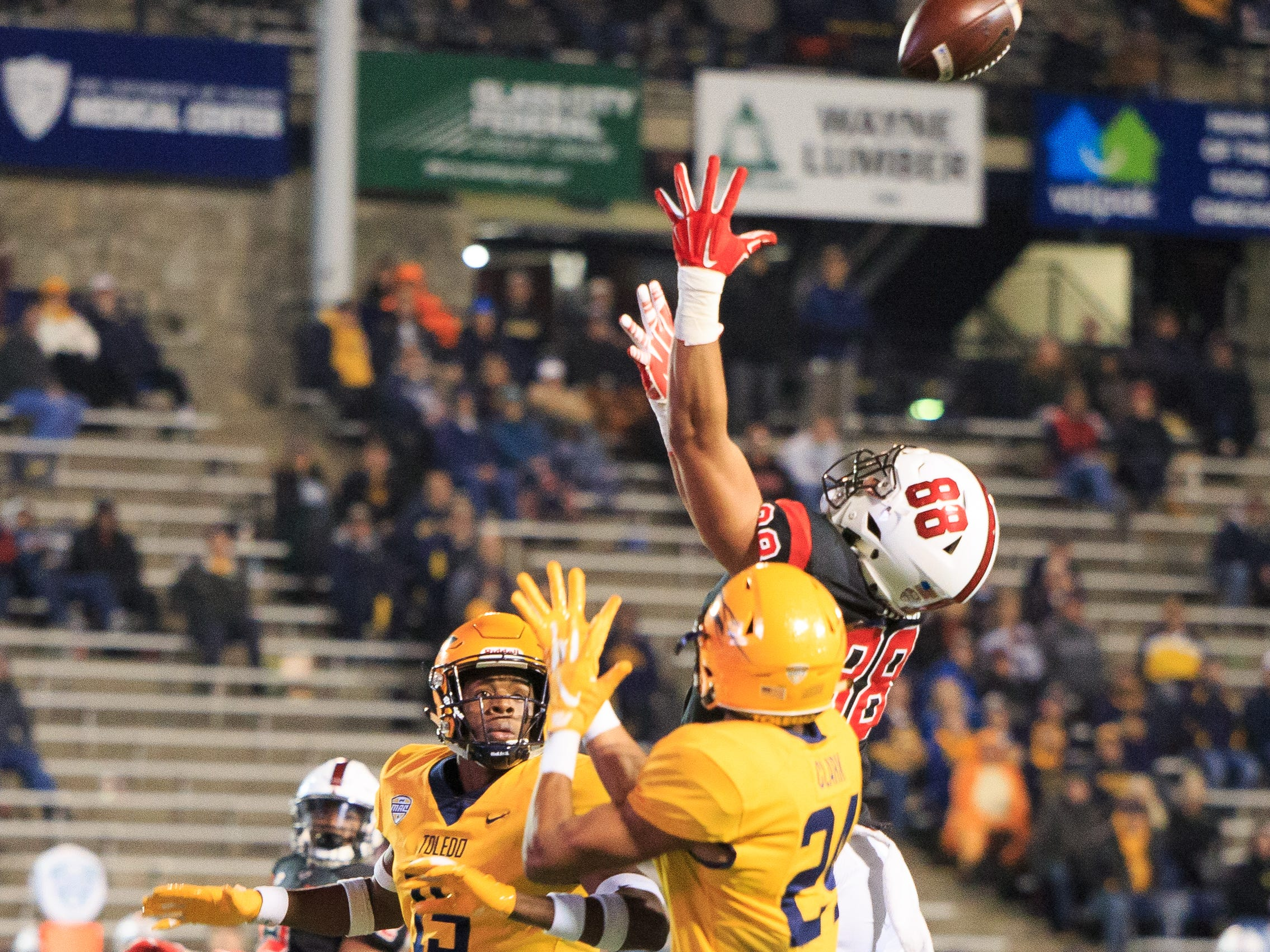 Ball State's Nolan Givan goes up for a catch in the game against Toledo. Toledo won the game, 45-13.