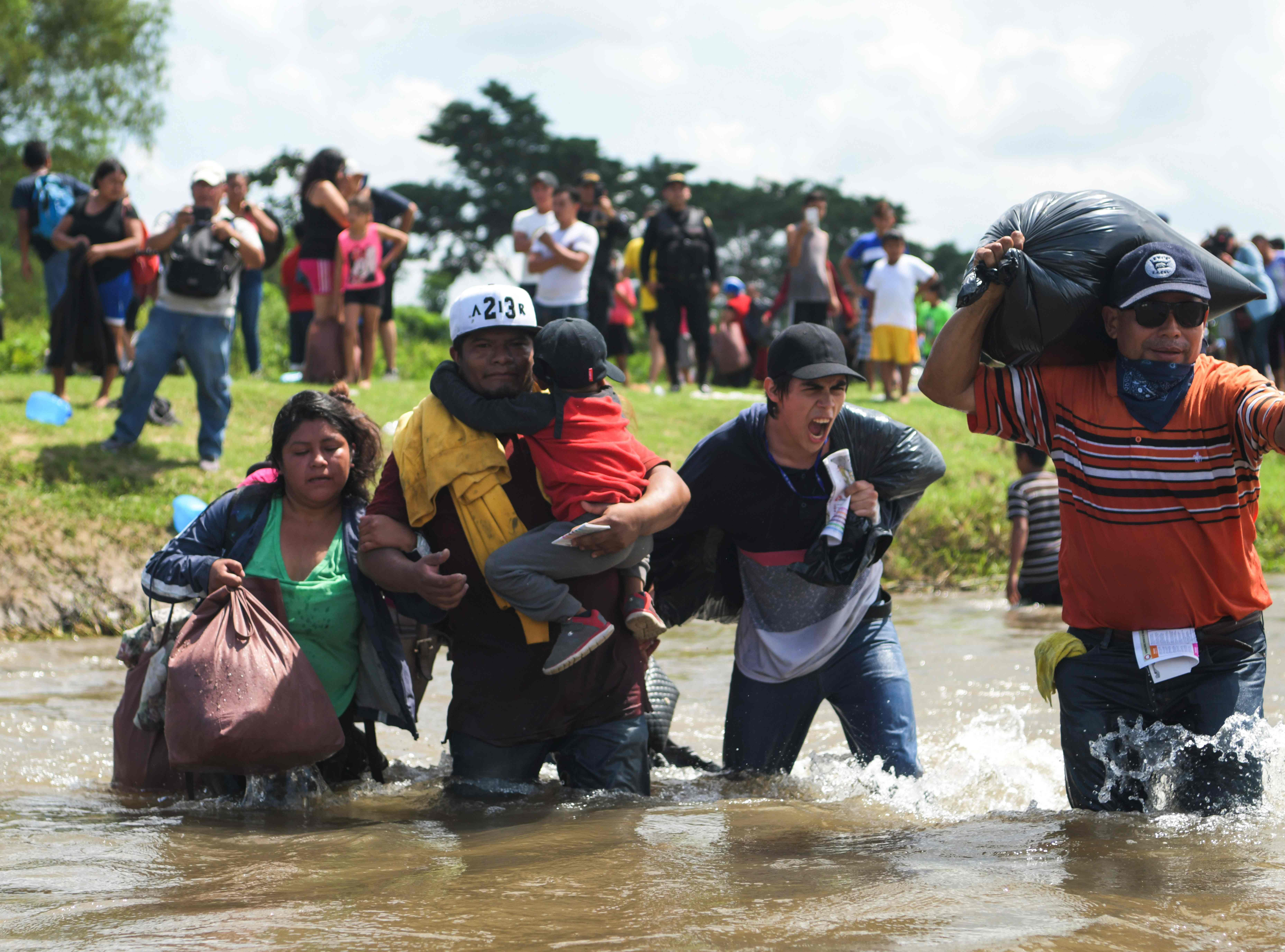 Salvadorian migrants heading in a caravan to the US, cross the Suchiate River to Mexico, as seen from Ciudad Tecun Uman, Guatemala, on Nov. 02, 2018.