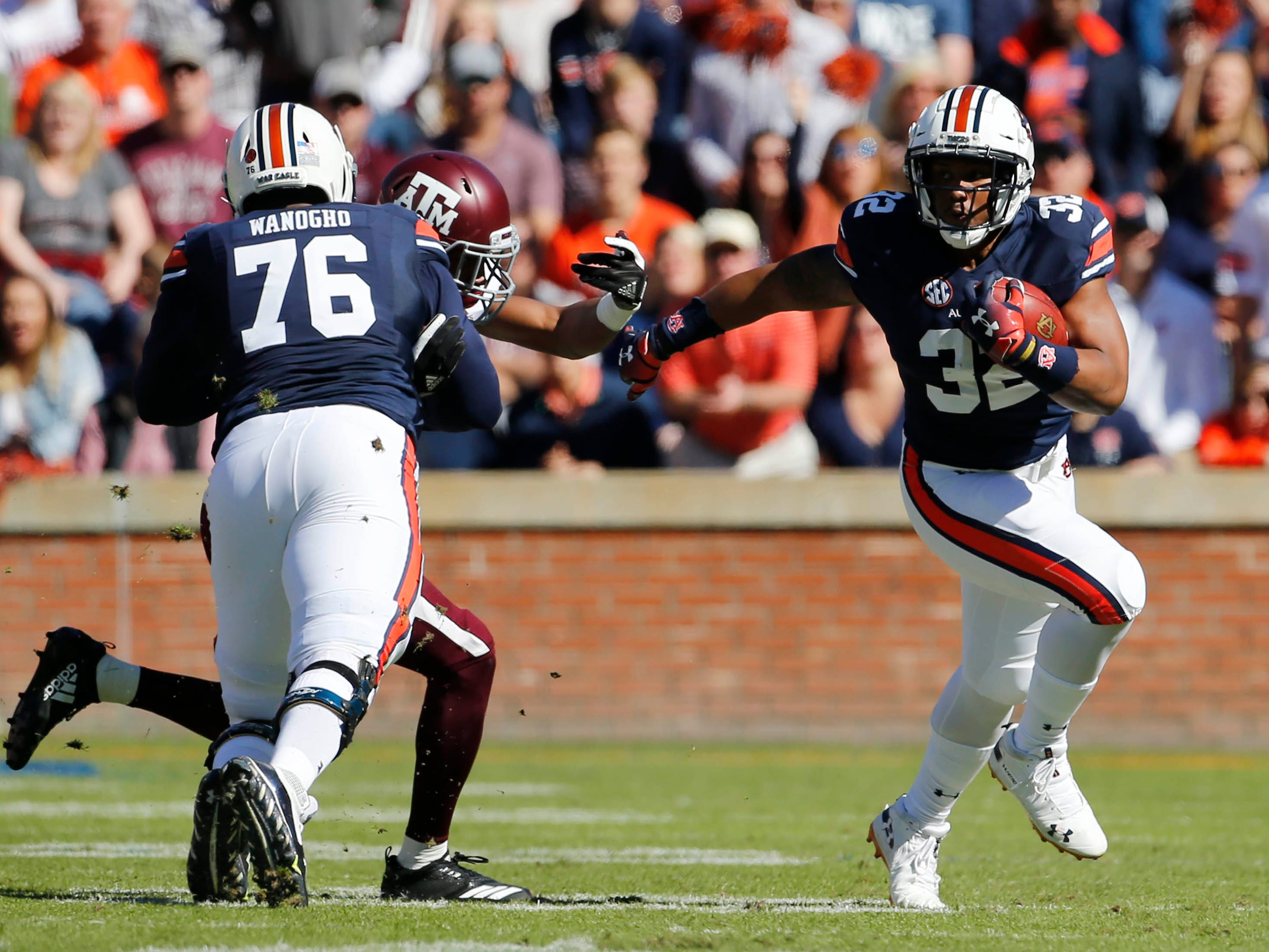 Auburn Tigers running back Malik Miller gets a good block from offensive lineman Prince Tega Wanogho in the first quarter against Texas A&M at Jordan-Hare Stadium.