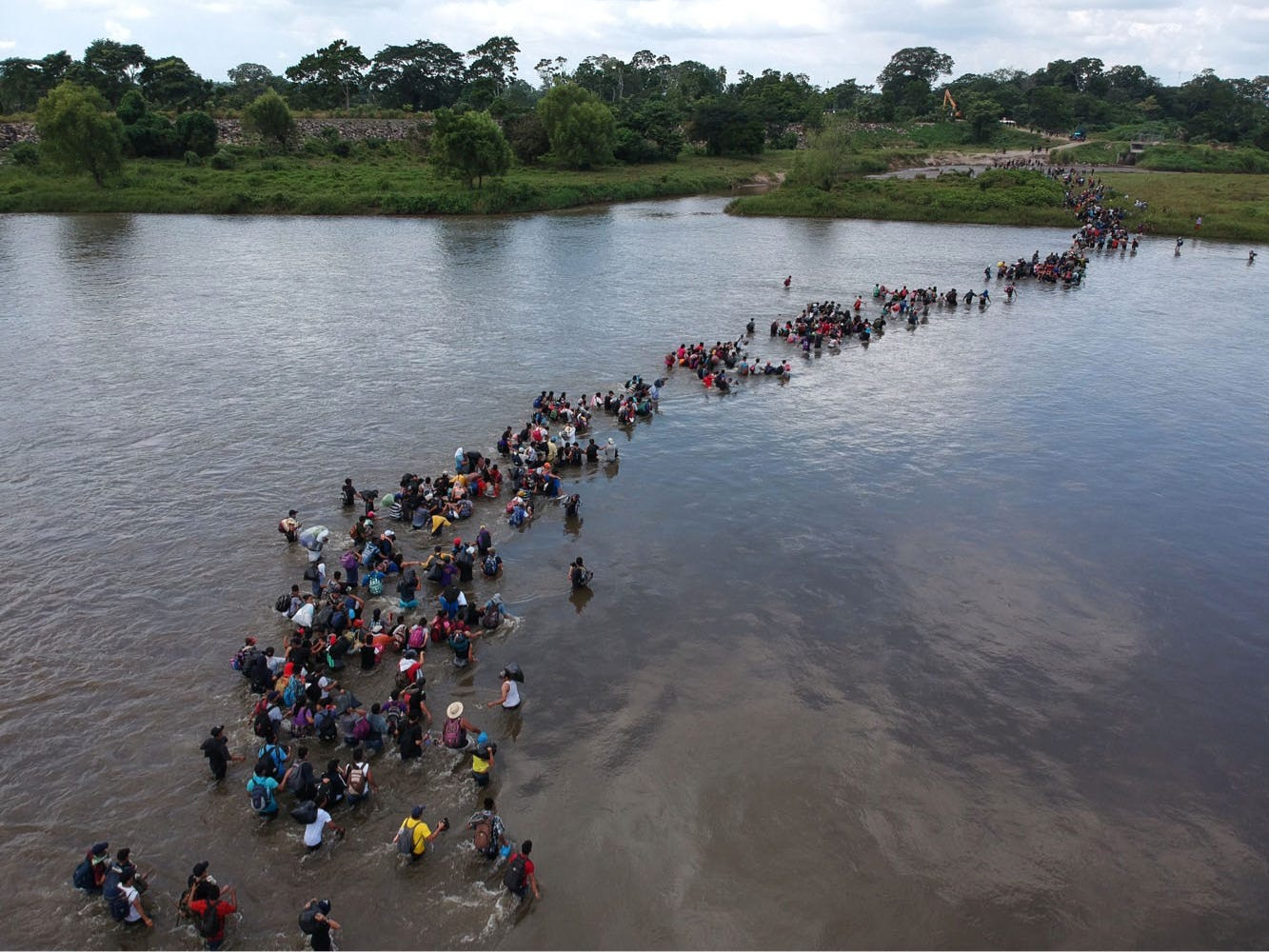 Salvadorian migrants heading in a caravan to the US, cross the Suchiate River to Mexico, from Ciudad Tecun Uman, Guatemala, on Nov. 02, 2018. According to the Salvadorian General Migration Directorate, over 1,700 Salvadorians left the country in two caravans and entered Guatemala Wednesday, in an attempt to reach the US.