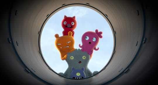"The ""UglyDolls"" explore their world: Lucky Bat (voiced by Wang Leehorn, top) Wage (Wanda Sykes, left), Moxy (Kelly Clarkson, right), Babo (Gabriel Iglesias, center) and Ugly Dog (Pitbull, bottom)."