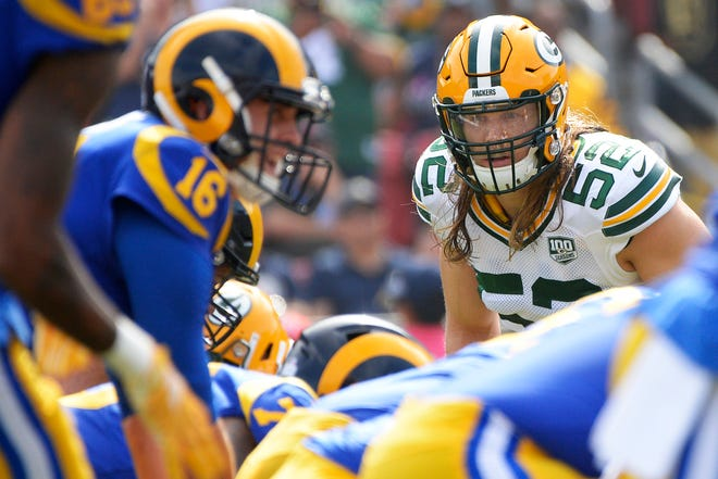 Green Bay Packers linebacker Clay Matthews (52) looks across the line before the snap against the Los Angeles Rams during the first quarter at Los Angeles Memorial Coliseum.
