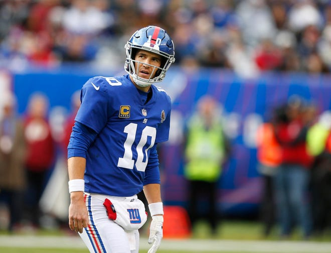 New York Giants quarterback Eli Manning reacts after being sacked by the Washington Redskins during second half at MetLife Stadium.
