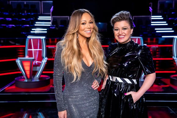"""Mariah Carey (L) and Kelly Clarkson on the dangerous stage of """"The Voice."""""""