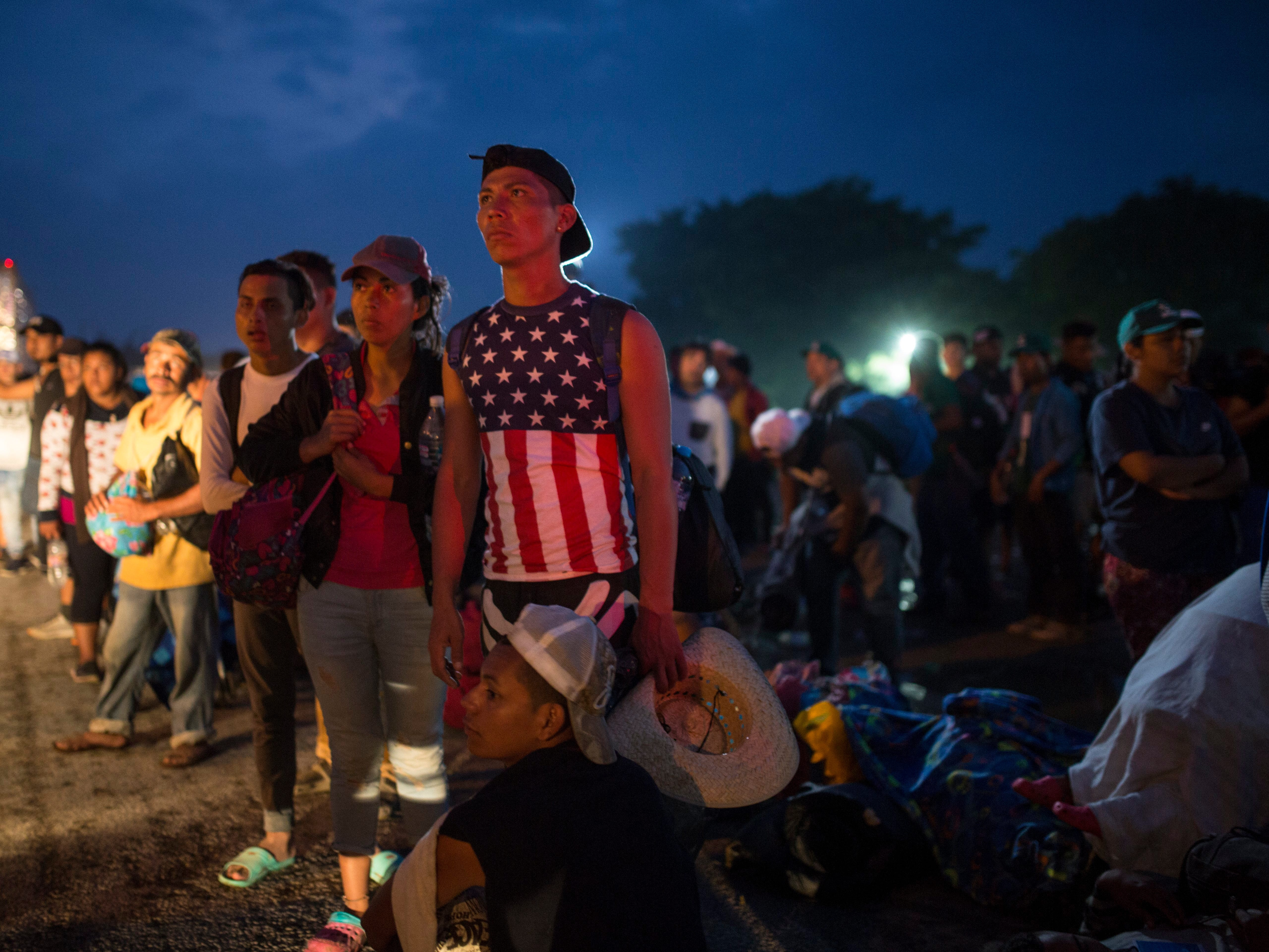 Central American migrants, part of the caravan hoping to reach the U.S. border, wait for a ride in Donaji, Oaxaca state, Mexico, Friday, Nov. 2, 2018.
