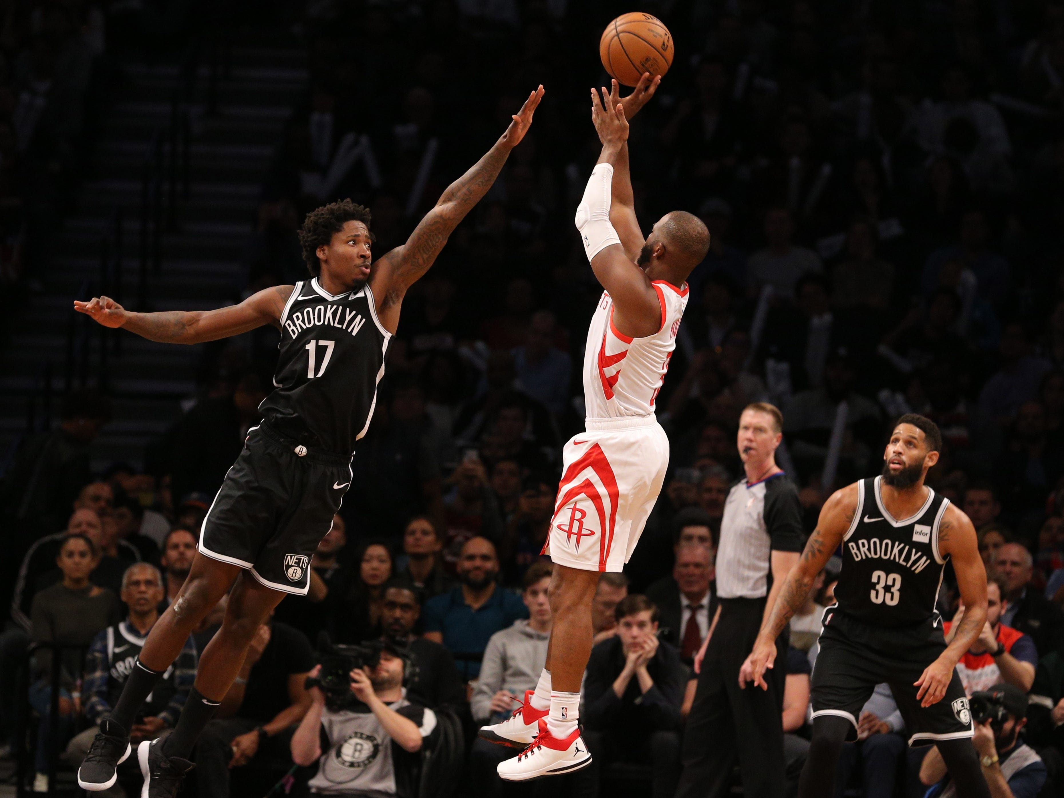 Nov. 2: Rockets guard Chris Paul (3) takes a fadeaway jumper over the out-stretched hand of Nets defender Ed Davis (17) during the second half in Brooklyn.