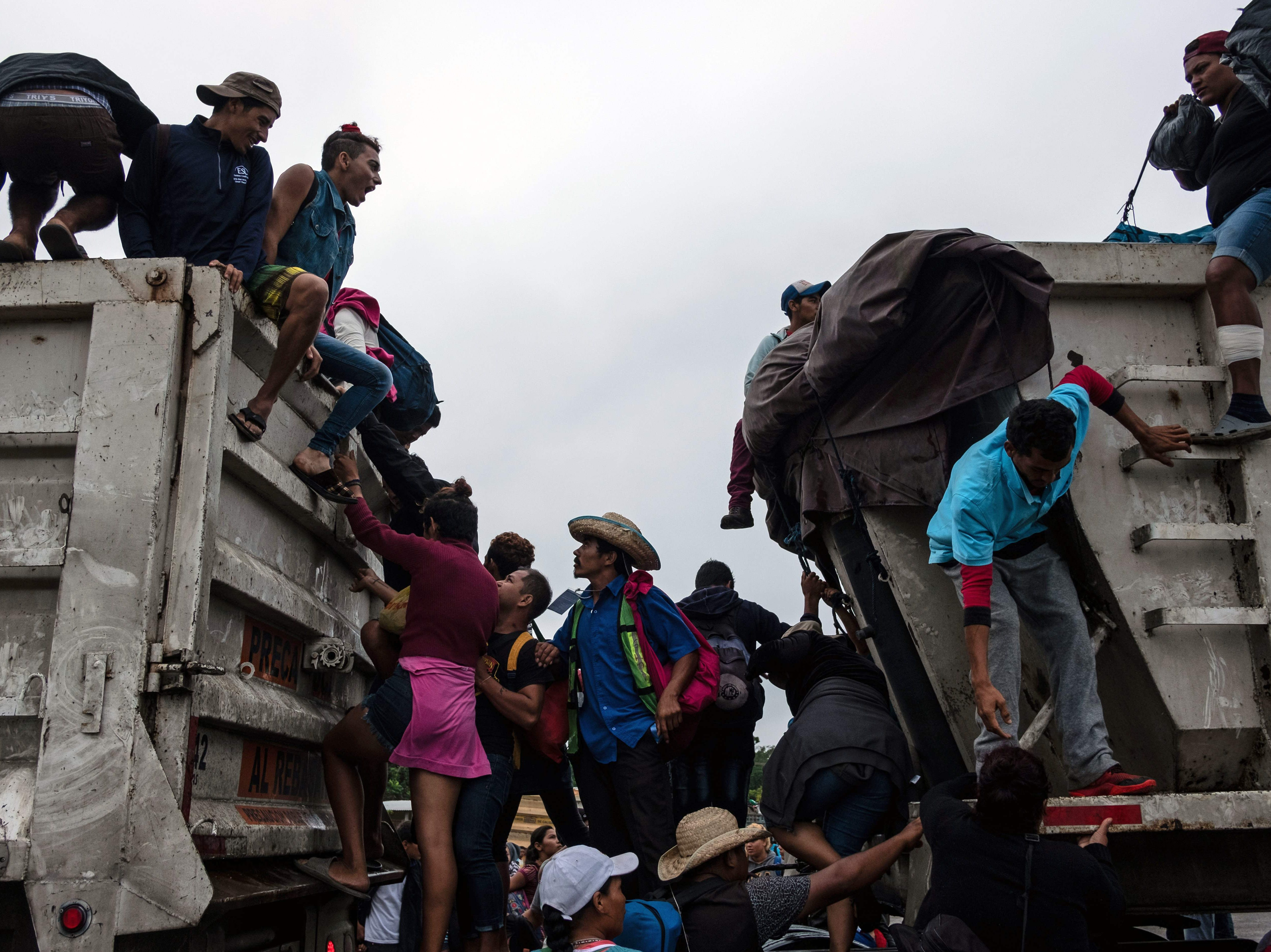 Migrants, mostly Hondurans, taking part in a caravan heading to the US, catch a ride on the road on their way to Isla, Veracruz  State, Mexico, on Nov. 3, 2018.