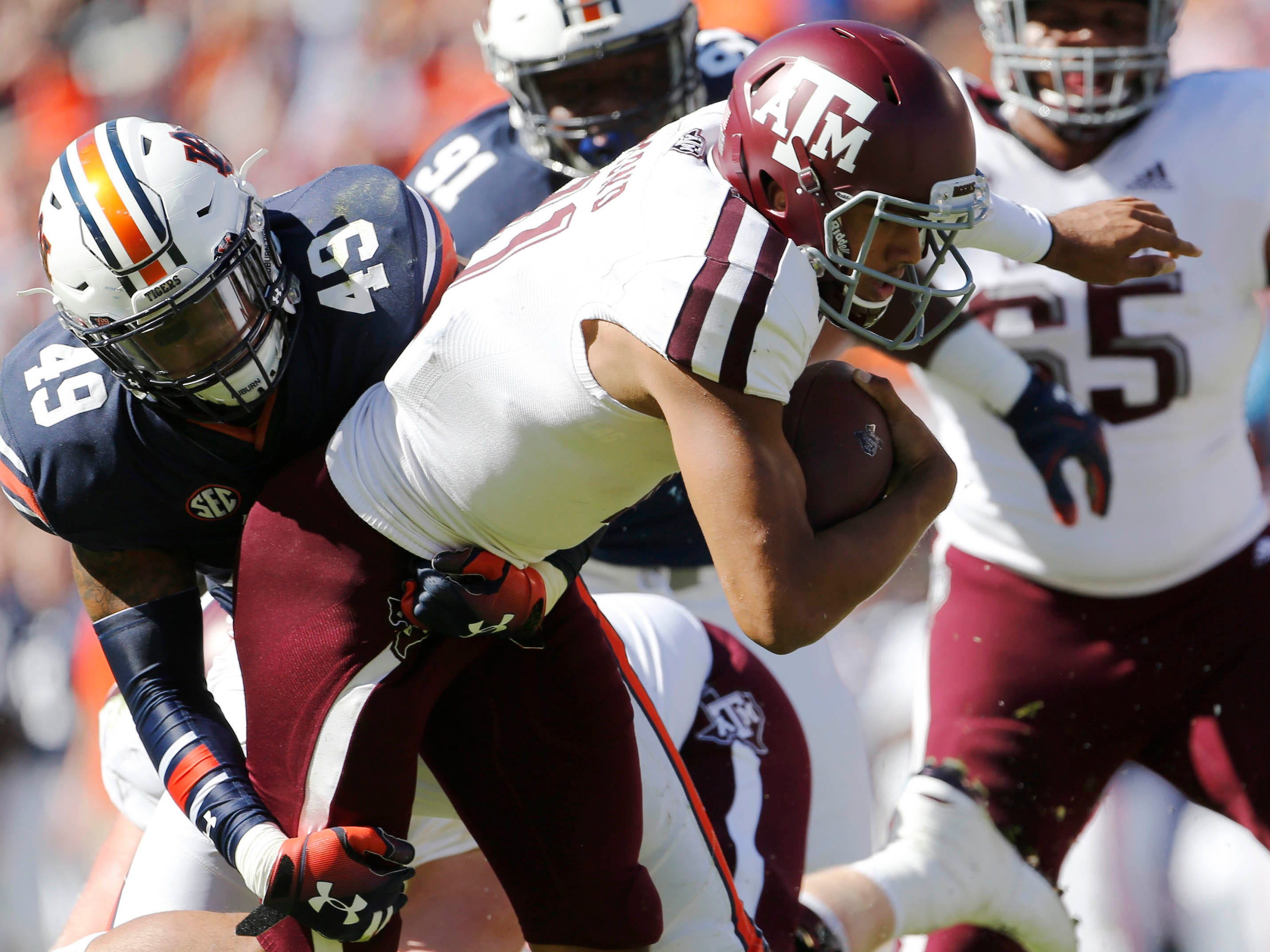 Auburn Tigers linebacker Darrell Williams (49) brings down Texas A&M Aggies quarterback Kellen Mond during the first quarter at Jordan-Hare Stadium.