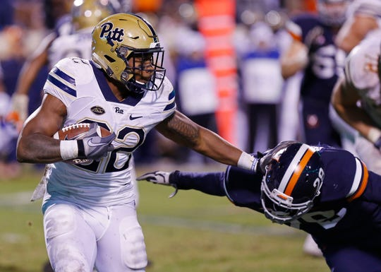 Pittsburgh running back Darrin Hall carries the ball against Virginia.