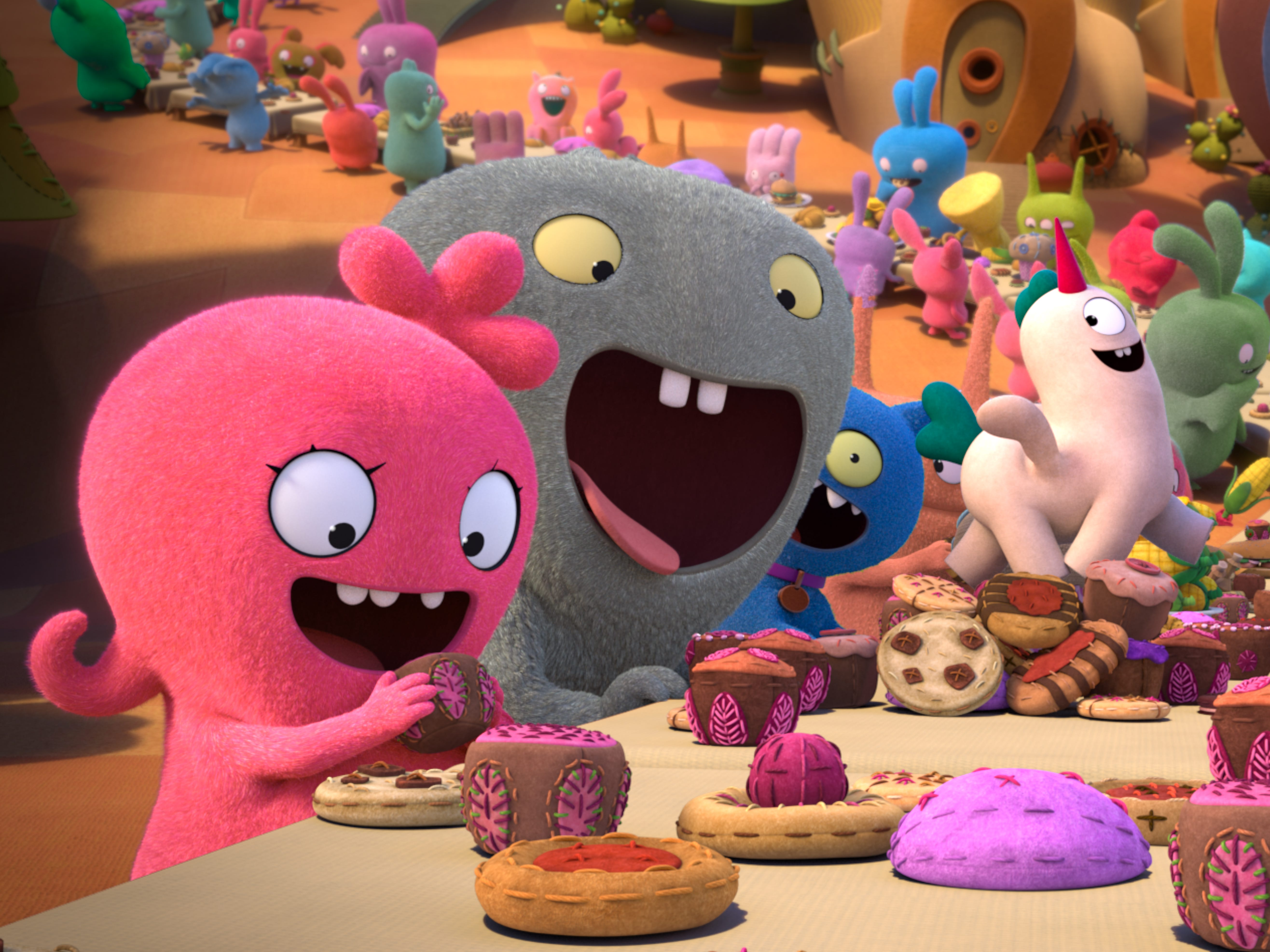Moxy (pink, voiced by Kelly Clarkson), Babo (gray, voiced by Gabriel Iglesias) and Lucky Bat (red, voiced by Wang Leehom) enjoy a well-balanced meal of cookies and cake.